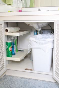 Kitchen Organization Tips and Tricks - Like the trash under the sink.  It would help prevent kitchen smells.