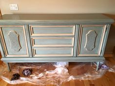 This was a dark floor model dresser. I added legs and gave it a bright blue and…