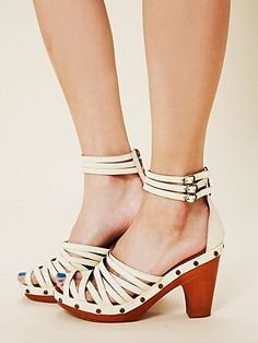 price:₪717.39  Strappy leather clog sandals with triple ankle buckle straps. Zips up back of heel. Stud detailing around bottom where sole meets wood. Low platform. A fresh footwear pick-me-up for spring.