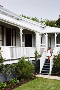 A Brisbane interior designer turned a heritage-listed Queenslander into a colourful and comfortable family home with an artistic decorating approach. home, A Heritage-Listed Queenslander In Brisbane Queenslander House, Weatherboard House, House With Porch, House Front, Exterior House Colors, Exterior Design, Brisbane, Veranda Railing, Moving House Tips
