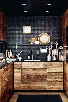 Kitchen with European Cabinets, U-shaped, 2 in. Solid Surface Countertop in Deep Nocturne, Hardwood floors, Slate counters