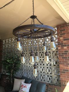 24 wagon wheel chandelier with 3 tiers of vintage bulb lights. Comes with 9 vintage bulbs.