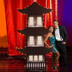 The Shanghai Moon Pagoda Standee has the look of an Asian pagoda accented with twinkle lights.