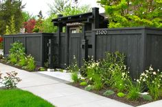front garden fencing ideas front yard fence privacy fence dark fence stock hill landscapes inc Cheap Privacy Fence, Privacy Fence Landscaping, Privacy Fence Designs, Cheap Landscaping Ideas, Backyard Privacy, Backyard Fences, Backyard Landscaping, Garden Fences, Black Garden Fence
