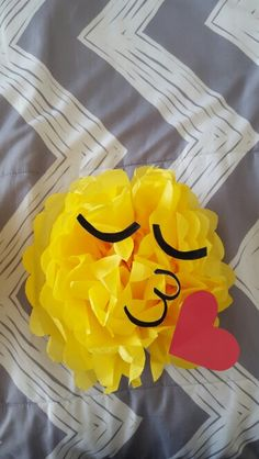 Tissue paper pom poms for emoji themed party