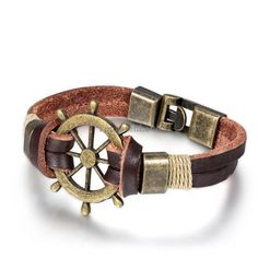Mens Bracelet: Bronze Rudder Tied into Leather Bracelet ships from U.S. - free shipping!! 1 1/2 inches wide and 8 inches long