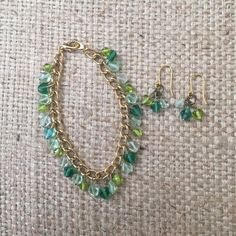 Bracelet and Earrings Set Matching bracelet and earrings  gold colored chain (not real gold) with 3 colors of green beads.  Bundle with other items in my closet for a discount!!  Jewelry