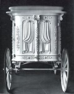 Beautiful carved back of 1890s Horse-drawn Hearse.