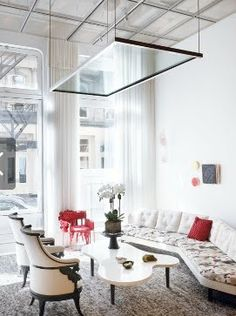 i saw a similar concept on 'sarah's summer house' where the floating table (on a winch-pulley system) drops down over the bed so you can enjoy breakfast in bed w/o annoying tray table legs!  future DIY