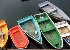 Colourful wooden boats moored to dock | Murray Mitchell