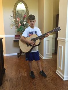 Gabriel bought his 1st Guitar with Chacha's help at the goodwill store June 2016.