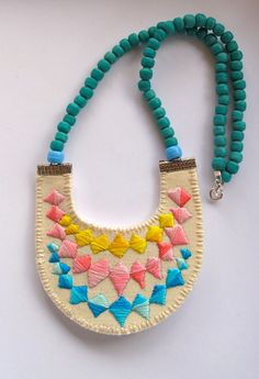 Colorblock bib necklace embroidered banner bunting triangle with Native American trade beads modern jewelry. $70.00, via Etsy.