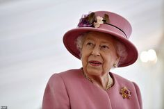 Dressed in a fetching blush coat and matching hat, Her Majesty was in good spirits as she ...
