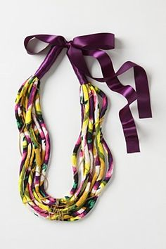Love the colors of this tribal tangle necklace! And the necklace,too.