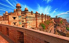 Gwalior is one of India's most historically significant cities. Located in the princely state of Madhya Pradesh, Gwalior has seen the rise and fall of various dynasties who have ruled its mighty towers. Visit the magnificent Gwalior Fort, the home of Tourist Places, Tourist Spots, History Of India, India Tour, India India, Madhya Pradesh, Beautiful Architecture, Rome Architecture, Tour Operator