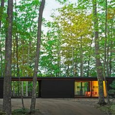 Milwaukee-based Johnsen Schmaling Architects completed a family retreat in rural Wisconsin featuring blackened pine cladding, concrete floors and wide-span glass doors.