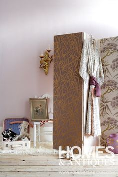 Group together prints with a common colour or pattern to create a practical and decorative dressing screen.
