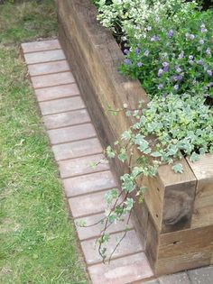 to Install a Mowing Strip of Bricks Installing a mowing strip of bricks.good articleInstalling a mowing strip of bricks. Brick Edging, Lawn Edging, Wood Garden Edging, Grass Edging, Brick Walkway, Stone Edging, Building A Raised Garden, Raised Garden Beds, Raised Beds