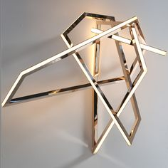 Gesture Mirror polished hand formed solid bronze Opal Glass Mosaic LEDs Gesture is a custom lighting piece by acclaimed contemporary international artist and light sculptor Niamh Barry