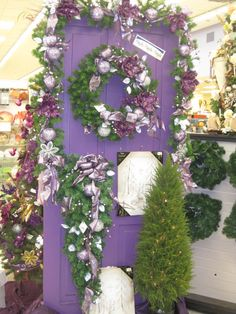 Wreath and garland From the Purple, Purple, Purple Theme at Your Christmas Shop at Stauffers of Kissel Hill Garden Centers. (http://www.skh.com/home-garden/departments-2/the-christmas-shop/)