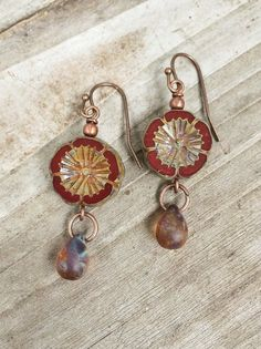 """Rustic burnt orange red Picasso flower cut Czech glass with small glass teardrop that perfectly accents the flowers finish. These small earrings are approx 1.5"""" in length."""