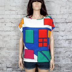 Super cute colorblock silky blouse~ Primary color square print top~ Boatneck neckline~ Buttoned top right shoulder~ Oversize box fit top~ Short dolman sleeve~Excellent condition~ Medium bust length Workout Tops, Boat Neck, Primary Colors, Color Blocking, Super Cute, Abstract, My Style, Stuff To Buy, Fashion