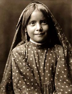 Here for your enjoyment is an exciting photograph of Cohit Songwi, a Tewa Indian Child. It was made in 1905 by Edward S. Curtis.    The photo illustrates a Head-and-shoulders portrait of this young Indian Child.    We have compiled this collection of photos mainly to serve as a vital educational resource. Contact curator@old-picture.com.    Image ID# F6C4C4B6