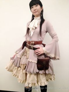 crystaline:  today's my steampunk lolita coordinate long cardigan - Ozz On Japan blouse - Ozz On Japan jabot - remake skirt - bodyline over skirt - Ozz On Japan belt - BRIGHTON belt pouches - remake
