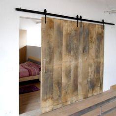 Schuifdeur op maat in oude eik voor de badkamer