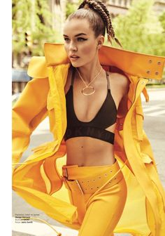 Josephine Skriver wears Versus Versace jacket and pants with DKNY bralette