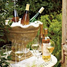 Love the idea of using an urn as a large wine bucket for entertaining. Adds character to the table. | The Micro Gardener