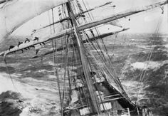 Reefing the main sail of the Garthnaird on a windy day. That took some strong arms and brave hearts. Finger nails were often ripped off in this kind of task. Photo taken from the fore mast cross tree. Grand shot!!