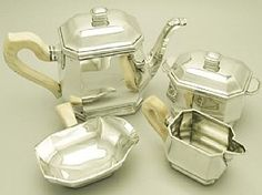 A fine and impressive antique French silver four piece service / set in the Art Deco style; part of our silver teaware collection http://www.acsilver.co.uk/shop/pc/French-Silver-Four-Piece-Tea-Service-Art-Deco-Style-Antique-97p3385.htm
