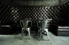 classic look  booths with reclaimed table and metal chairs