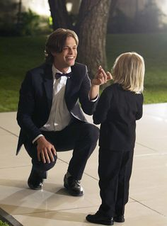 Photo from the season 7 finale of CM. Reid shows his godson, Henry, some magic.