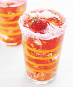 Cranberry Spritzer: Once you serve this festive drink once, your guests are sure to request it year after year. The cranberry-apple-strawberry mash-up gets an added dose of sweetness from a sugary rim (and an extra strawberry on top!). For an adult version, add 1 ounce of vodka to each drink.