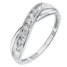 9ct white gold cross over eternity ring featuring a single channel set row of cubic zirconia. The perfect celebration gift.