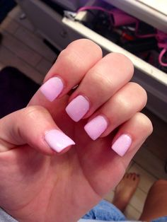 Perfect light pink acrylic nails with a hint of sparkle , very cute and classy
