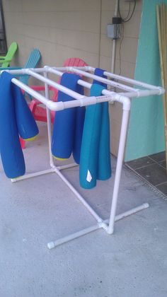 Husband made me a towel rack for the pool towels. ... Uploaded with Pinterest…