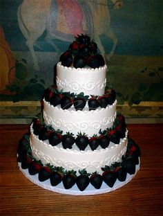 Yummy looking wedding cake with chocolate covered strawberries