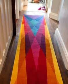 Long hallways are common at the Perry Street Lofts.  This rug adds color and matches the accent walls perfectly!
