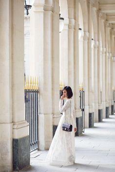 white lace Valentino maxi dress + black Chanel bag