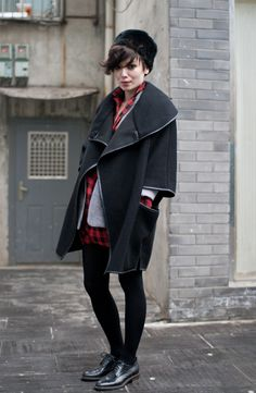 Amihan Zemp (NEEMIC) in black furry hat, black oversized coat over buffalo plaid shirt and check blazer, black leggings and black brogue shoes.   Photo by Suzy Seidler / 北京 Stylites