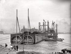 """TUNNEL: """"Sinking the Tunnel"""" 1910 construction of a railway tunnel for the Michigan Central Railroad Co. under the Detroit River"""