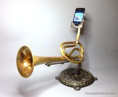 The Analog Tele-Phonographer is Christopher Locke's fantastic smartphone amplifier made from salvaged, chimeraed brass instruments. Each one is different, and each one is awesome in its own way.