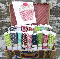 suitcase display for burp cloths, bibs and/or kitchen towels