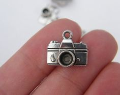 8 Camera charms  ( double sided ) 15 x 14mm  tibet silver