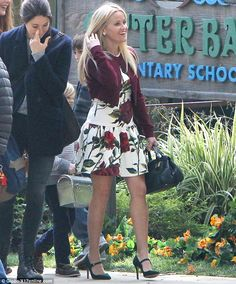 Back to business: Last weekend, the stunner was spotted filming Big Little Lies while wearing a floral dress and a crimson cardigan