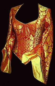 red/gold brocade medieval wedding gown. I would pair it with a black velvet skirt.