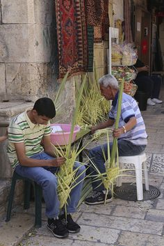 Father and son at work, braiding palms for Palm Sunday -  Jerusalem
